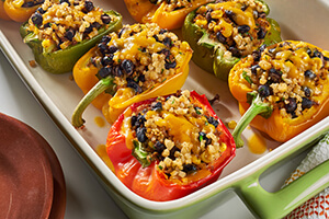 Mexican stuffed peppers in a baking dish on the table