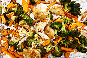 a sheet pan dinner with rotisserie chicken and vegetables